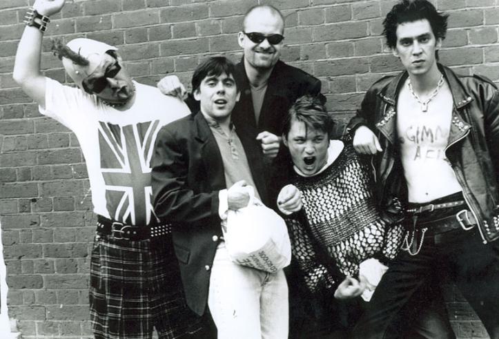 Paul Putner, Paul Reynolds, Ewan Bailey, Richard Herring and Jason Freeman in Punk's Not Dead (1996).