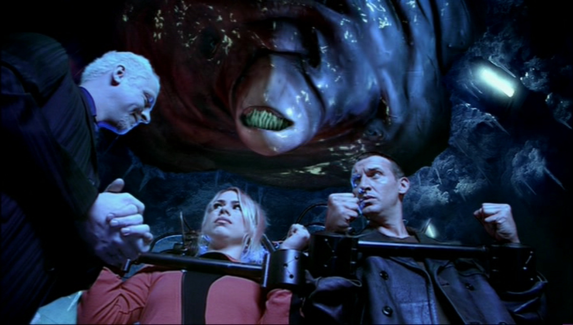 Simon Pegg as The Editor, Billie Piper as Rose Tyler and Christopher Eccleston as The Doctor in Doctor Who - The Long Game (BBC1, 2005).